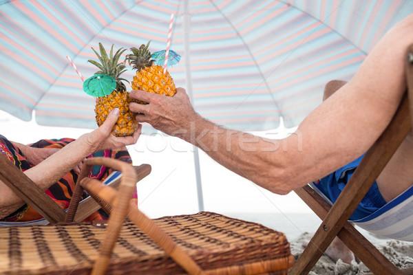 Idős pár megnyugtató hátsó nézet ül pirít ananász Stock fotó © wavebreak_media