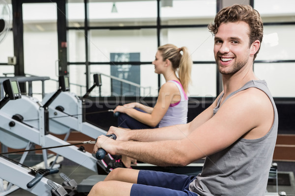 Portrait of man working out on rowing machine Stock photo © wavebreak_media