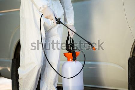 Midsection of manual worker using spray on wall Stock photo © wavebreak_media