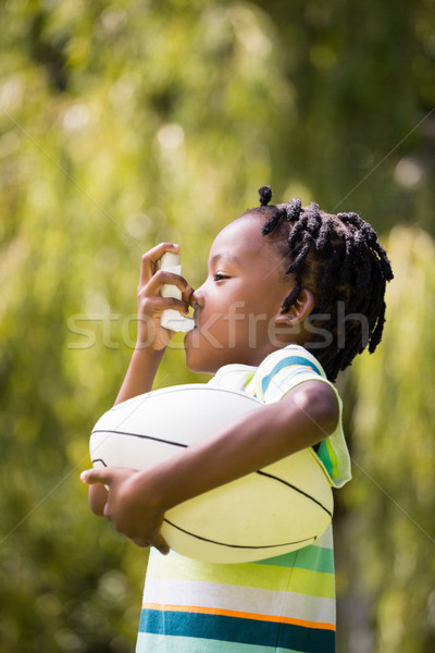 Profile view of a kid using an asthma inhaler Stock photo © wavebreak_media
