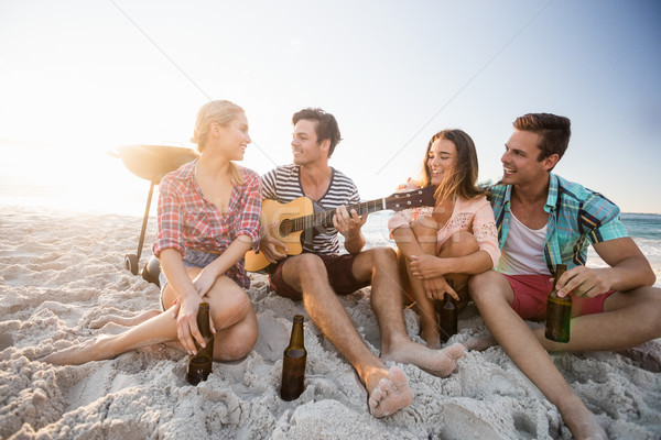 Stock photo: Friends playing the guitar