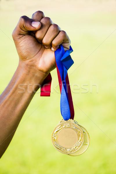 Sportolók kéz tart aranyérem győzelem közelkép Stock fotó © wavebreak_media