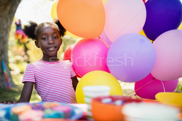 Cute girl posing next to balloon on a birthday party Stock photo © wavebreak_media