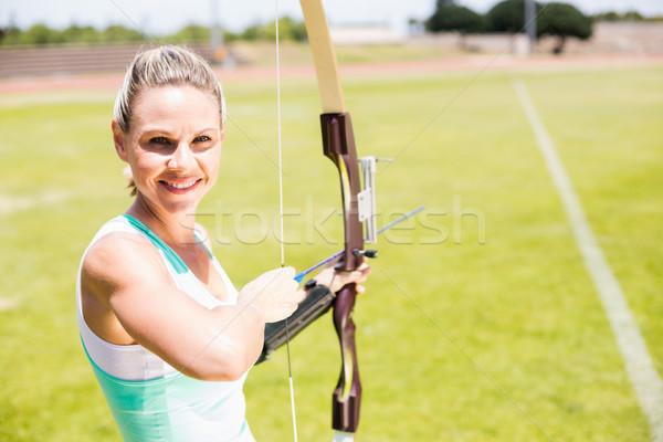 Portré női atléta gyakorol íjászat stadion Stock fotó © wavebreak_media