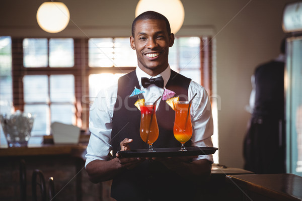 Bartender holding serving tray with two glass of cocktail  Stock photo © wavebreak_media