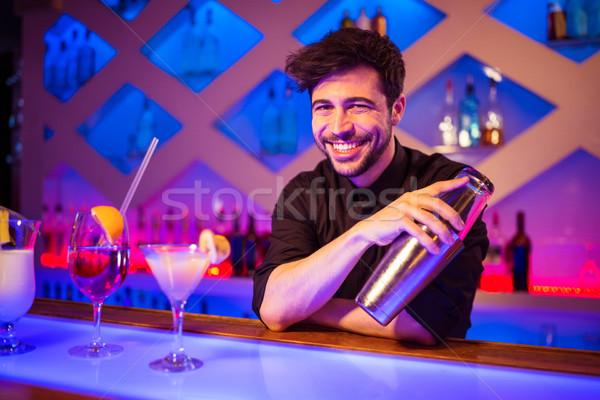 Csapos mosolyog tart koktél shaker portré Stock fotó © wavebreak_media