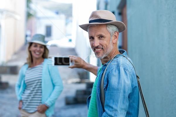 Man photographing woman in city Stock photo © wavebreak_media