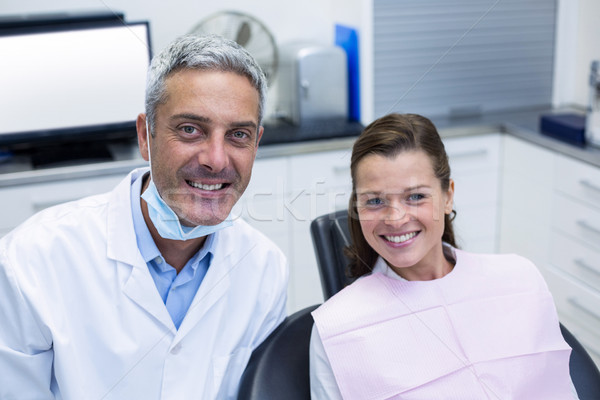 Portrait of smiling dentist and young patient Stock photo © wavebreak_media