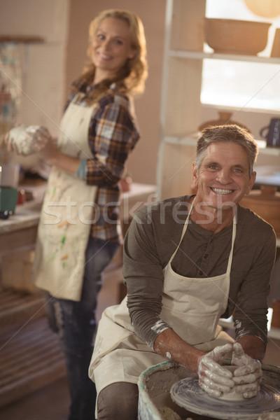 Smiling male potter making pot in pottery workshop Stock photo © wavebreak_media