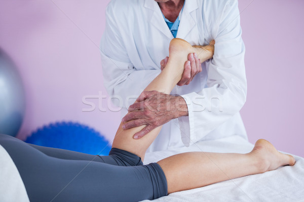Physiotherapist giving leg massage to a woman Stock photo © wavebreak_media