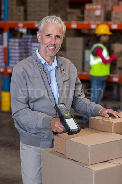 Portrait of warehouse manager scanning the boxes Stock photo © wavebreak_media