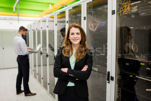 Technician standing with arms crossed in a server room Stock photo © wavebreak_media