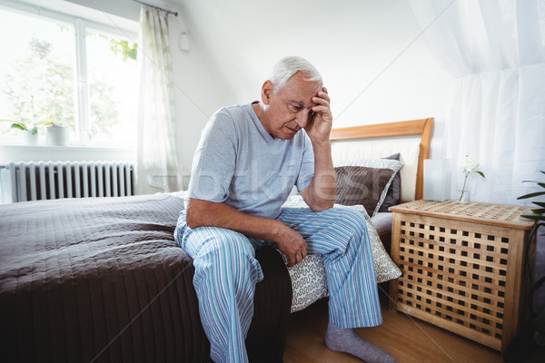Stock photo: Frustrated senior man sitting on bed