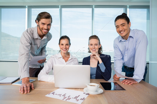 Smiling business executives in conference room Stock photo © wavebreak_media