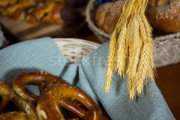 Ears of wheat and pretzel breads at counter Stock photo © wavebreak_media