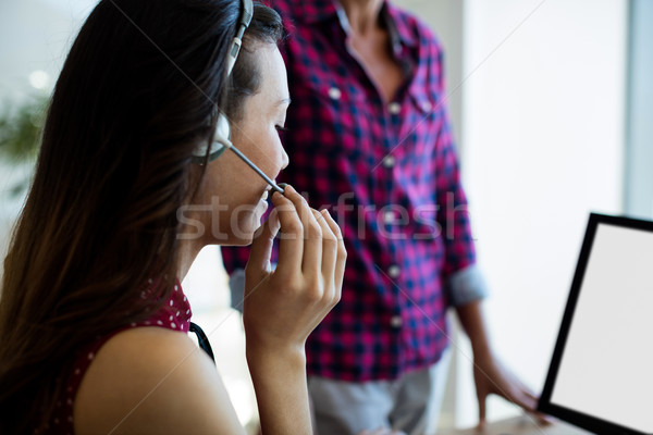 Müşteri hizmetleri yürütme konuşma kulaklık ofis bilgisayar Stok fotoğraf © wavebreak_media