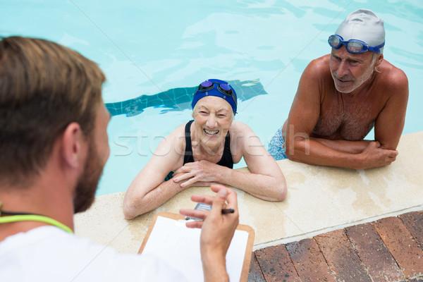Zwemmen coach man gelukkig pen Stockfoto © wavebreak_media