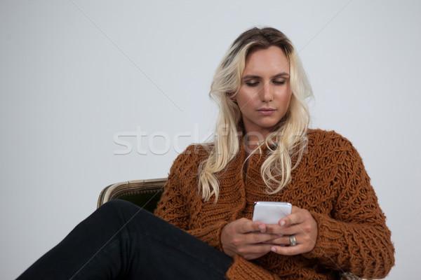トランスジェンダー 携帯電話 座って 椅子 電話 男 ストックフォト © wavebreak_media
