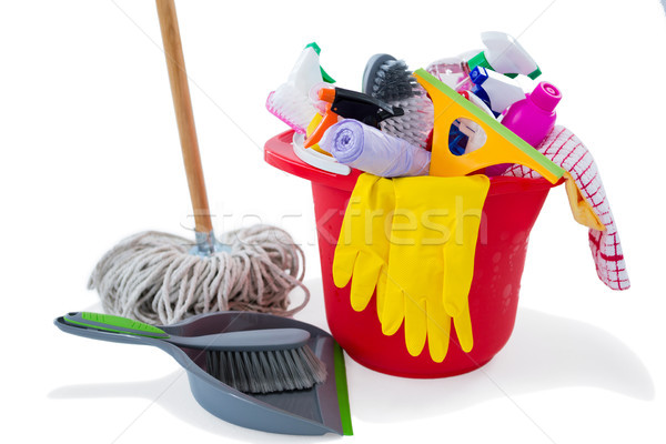 Mop and dustpan by cleaning products in bucket Stock photo © wavebreak_media