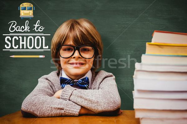 Stock photo: Composite image of pupil with many books