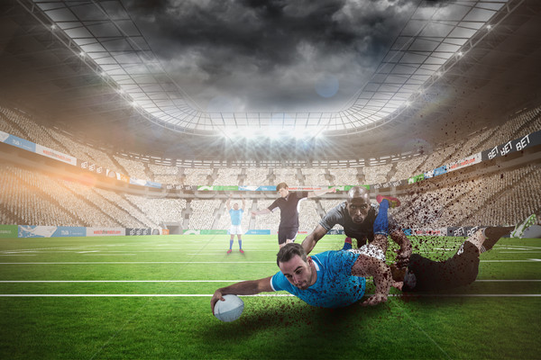 Composite image of rugby player doing a drop kick Stock photo © wavebreak_media