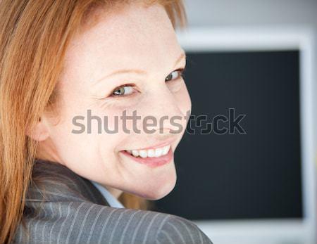 Self-assured business woman working on a computer Stock photo © wavebreak_media