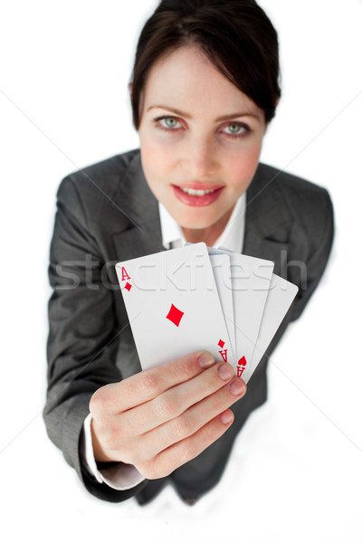 Charming businesswoman holding a full deck aces  Stock photo © wavebreak_media