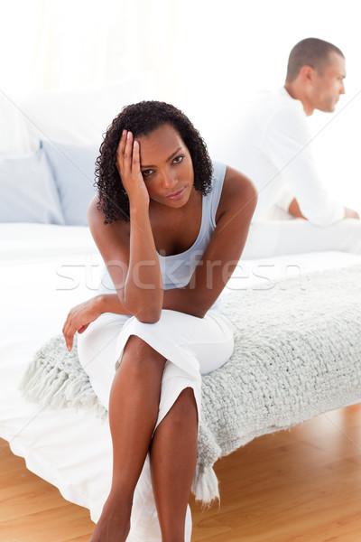 üzgün çift oturma yatak kız erkek Stok fotoğraf © wavebreak_media