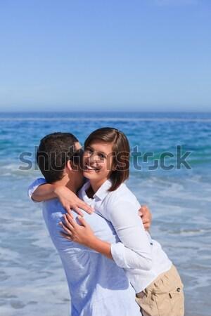 Szerelmes pár csók part vonal szeretet Stock fotó © wavebreak_media