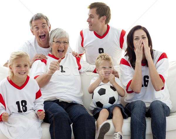Família assistindo futebol combinar televisão casa Foto stock © wavebreak_media