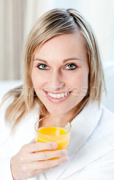 Portrait of a smiling woman holding an orange juice Stock photo © wavebreak_media