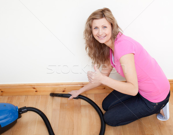 Stock photo: Portrait of a cheerful woman vacuuming