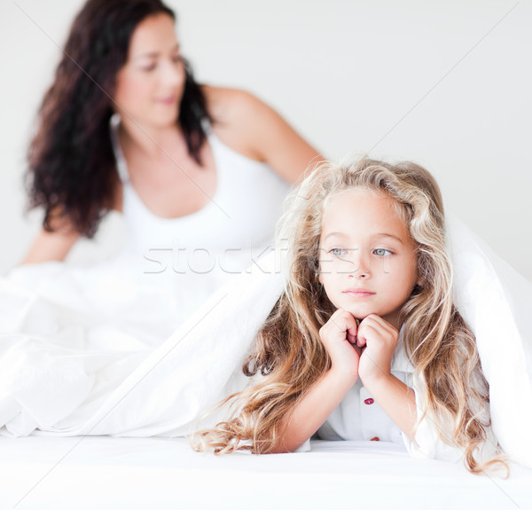Lively mother and daugther embracing on bed Stock photo © wavebreak_media