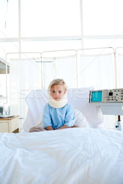 Upset little girl with a neck brace Stock photo © wavebreak_media