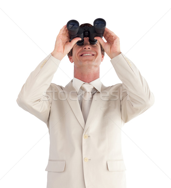 Portrait of a positive businessman with binoculars isolated against white background  Stock photo © wavebreak_media