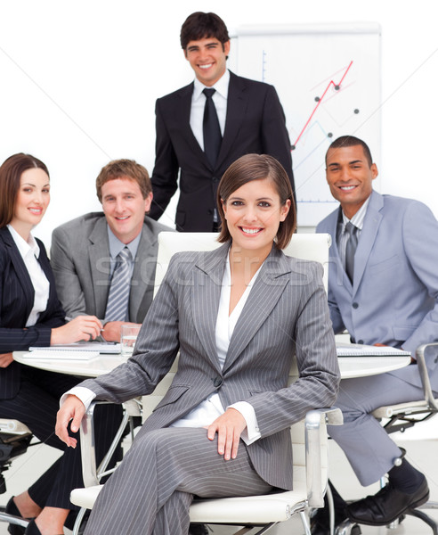 Assertive female executive sitting in front of her team in a meeting Stock photo © wavebreak_media