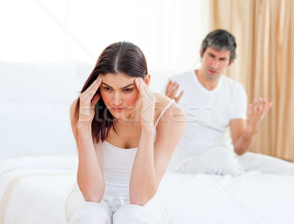 Angry couple having an argument in their bedroom Stock photo © wavebreak_media