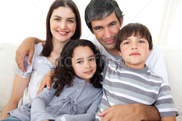 Ritratto amorevole famiglia seduta divano home Foto d'archivio © wavebreak_media