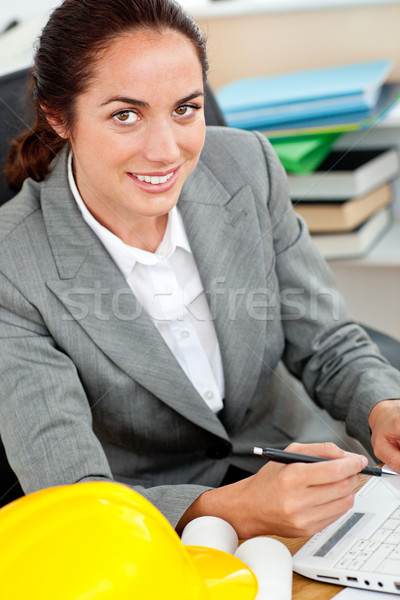 Delighted female architect working in her office Stock photo © wavebreak_media