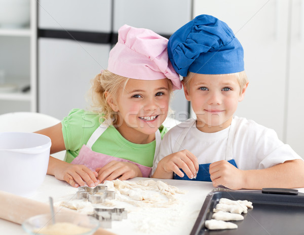 Portrait of two adorable children baking in the kitchen at home Stock photo © wavebreak_media