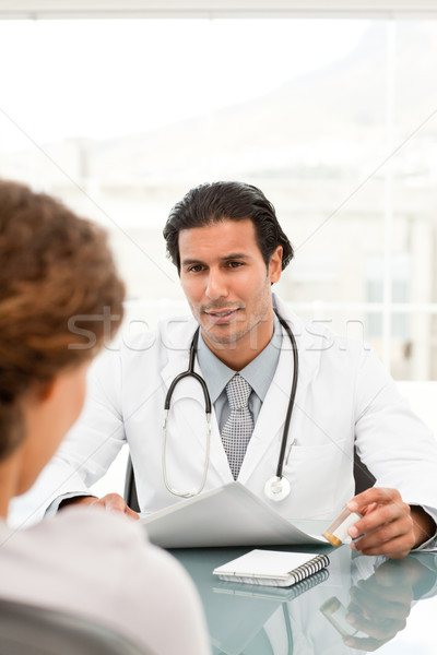 Rear view of a female patient during an appointment with her doctor at the hospital Stock photo © wavebreak_media