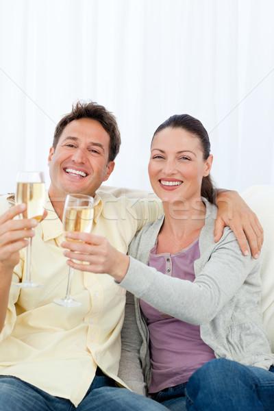 Mutlu çift flüt şampanya oturma Stok fotoğraf © wavebreak_media