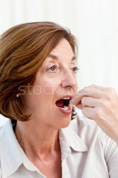 Senior taking pills at home Stock photo © wavebreak_media