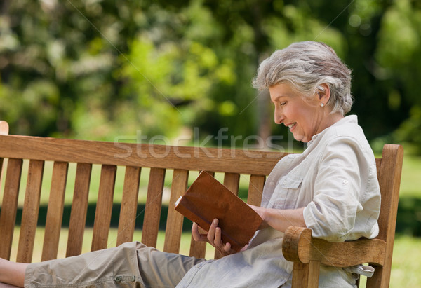 Retired woman reading a book on the  bench Stock photo © wavebreak_media