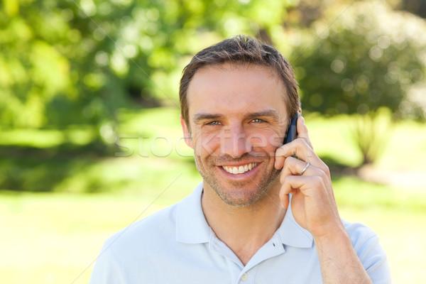 Handsome man phoning in the park Stock photo © wavebreak_media