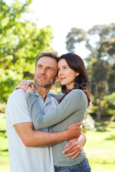 Radiant couple hugging in the park Stock photo © wavebreak_media
