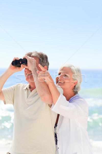Senior couple bird watching at the beach Stock photo © wavebreak_media