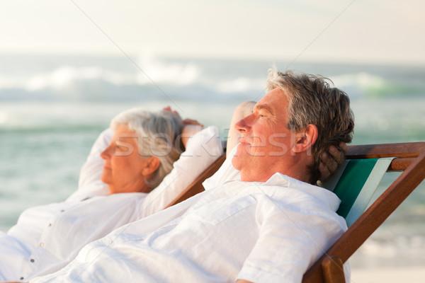 Anziani Coppia rilassante deck sedie donna Foto d'archivio © wavebreak_media