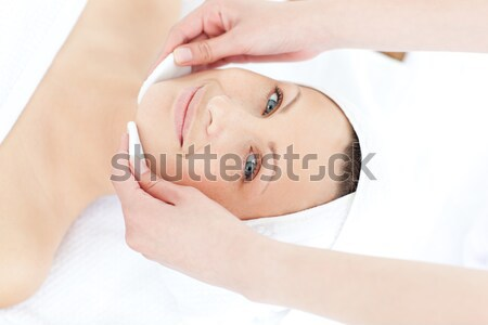 Attractive blond-haired woman relaxing while lying down in a Spa centre Stock photo © wavebreak_media