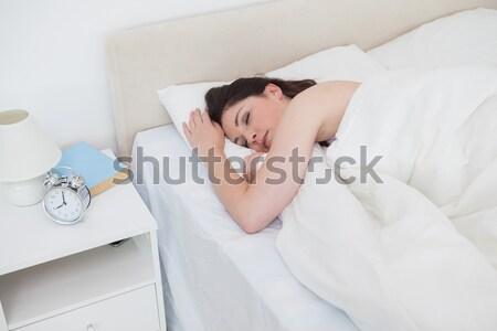ストックフォト: かわいい · 女性 · オフ · 目覚まし時計 · ベッド · 手